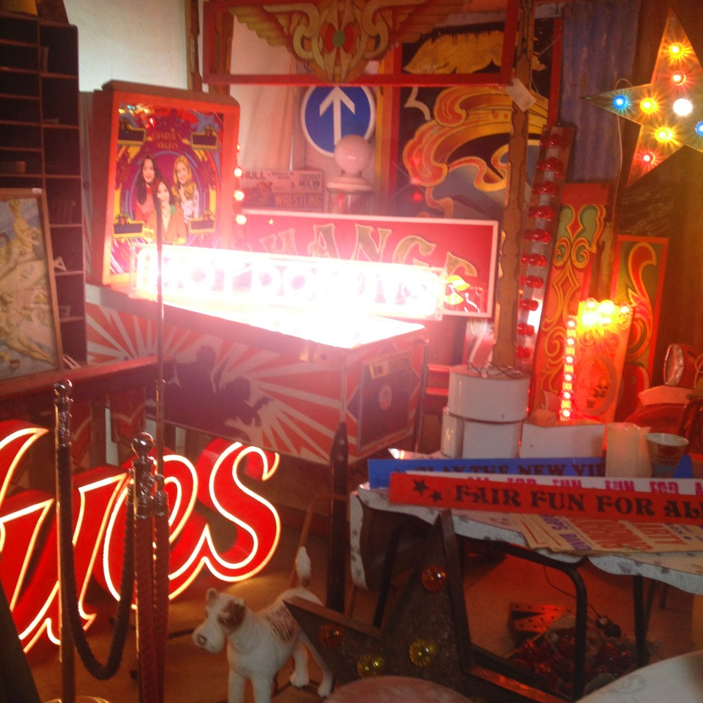 Fairground signage and vintage arcade games in Old Albion, Bridport
