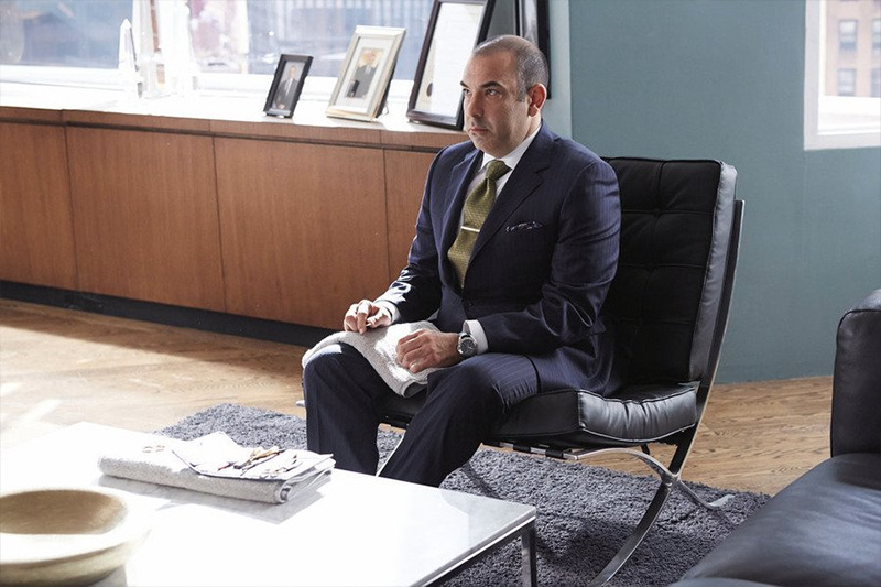 Suits: Louis Litt in a black leather Barcelona Chair