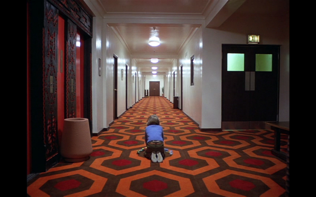 Danny-corridor-hexagonal-carpet-the-shining-kubrick