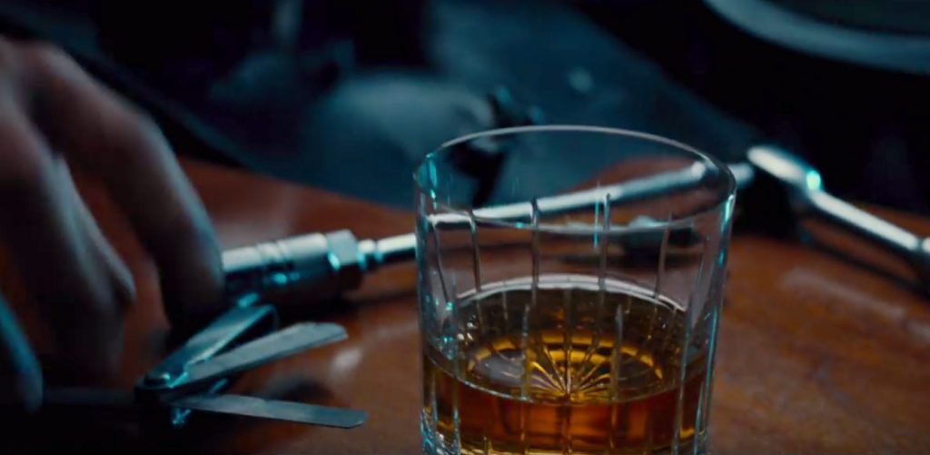 Whisky vibrates in the Baccarat whisky glass indicating someone is approaching, in Justice League Comic Con trailer