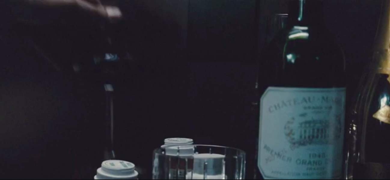 On Bruce Wayne's bedside table we also see a Baccarat whisky glass