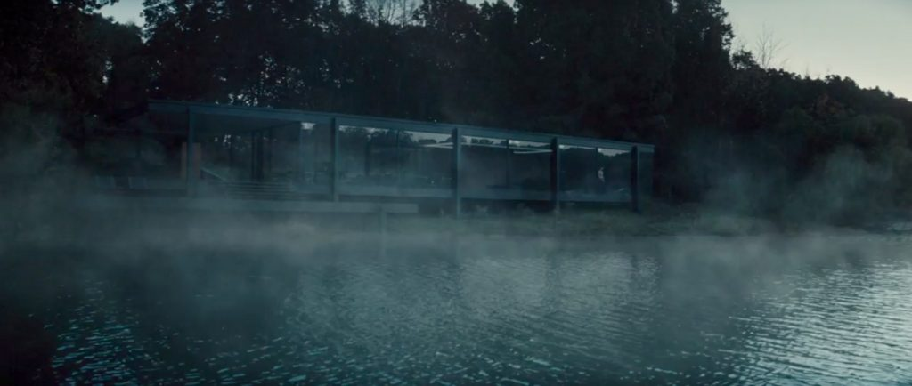 Bruce Wayne's lakeside house seen in the moody early morning light in Justice League
