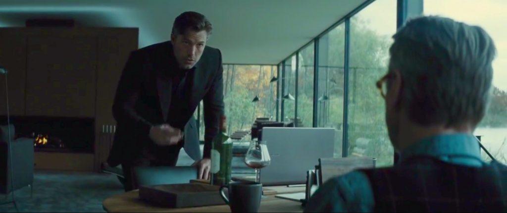 Bruce Wayne talks to Alfred in his modernist lakeside house in Batman v Superman