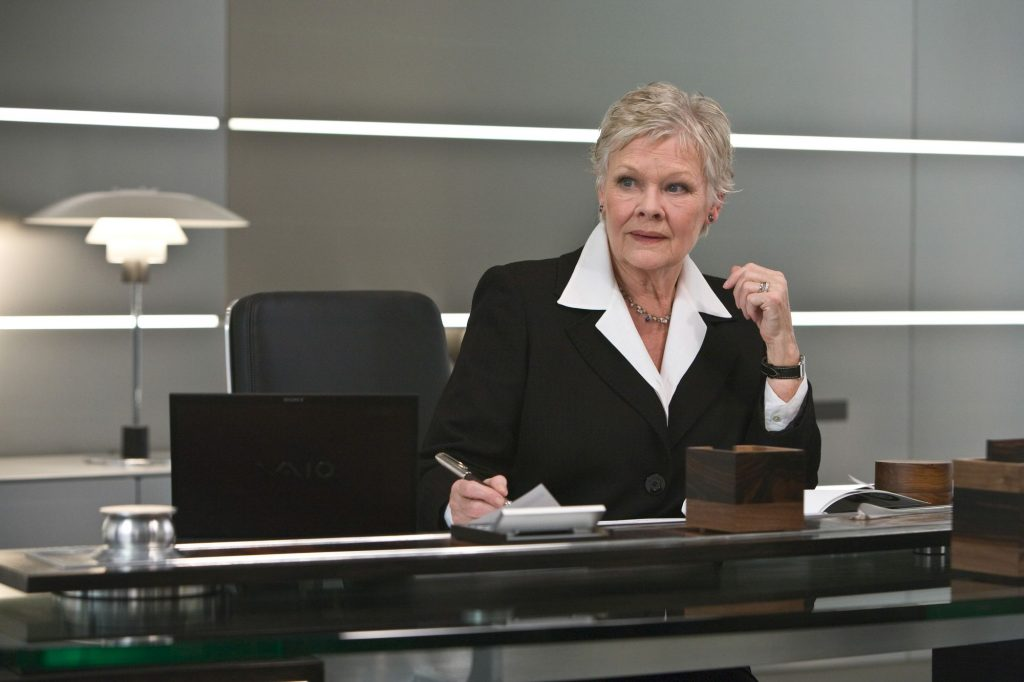Judi Dench as M in Quantum of Solace sitting in an Interstuhl Silver Chair