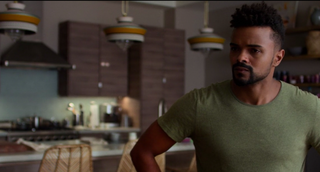 Malcolm Ducasse (Eka Darville) in Trish Walker's kitchen in Jessica Jones