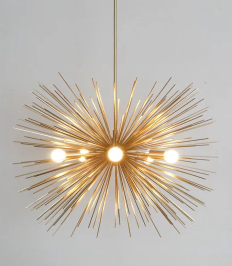 Mid Century Modern Large Gold Brass Starburst Chandelier. £373 from Etsy.