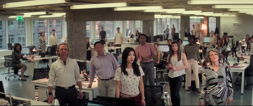 The office workers look on disbelief as Tom Cruise realises he has no choice but to jump through the window