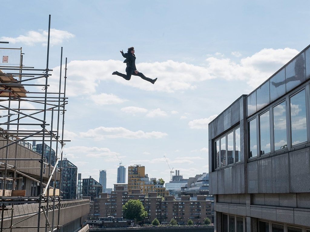 Tom Cruise as Ethan Hunt filming jumping scenes in London. This is the scene where he broke his ankle