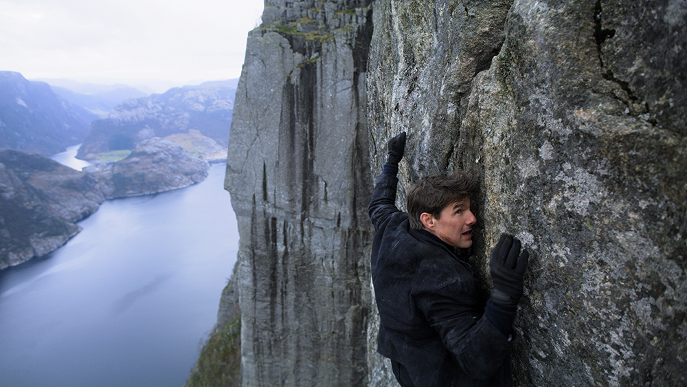 Tom Cruise as Ethan Hunt freeclimbing in Mission: Impossible - Fallout