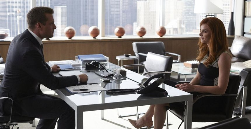 Donna sits in Brno chairs in Harvey's office in Suits