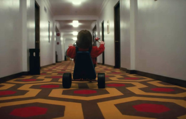 Danny on his tricycle in the Overlook Hotel - an exact recreation of Kubrick's The Shining