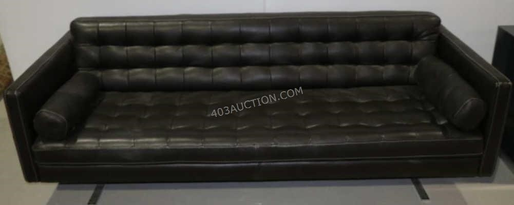 Suits: Harvey Specter's black sofa couch