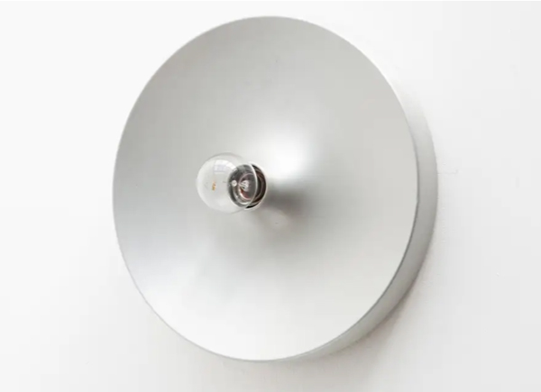 space-age-silver-wall-light-film-and-furniture
