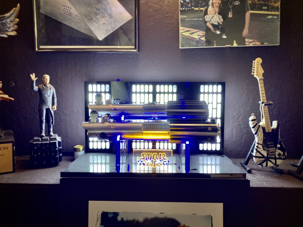 Greg's lightsabres sit proudly in his home office