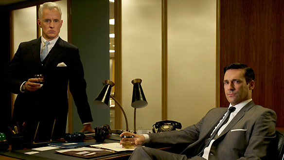 Don and Roger fuel their day with whiskey drinking in Mad Men