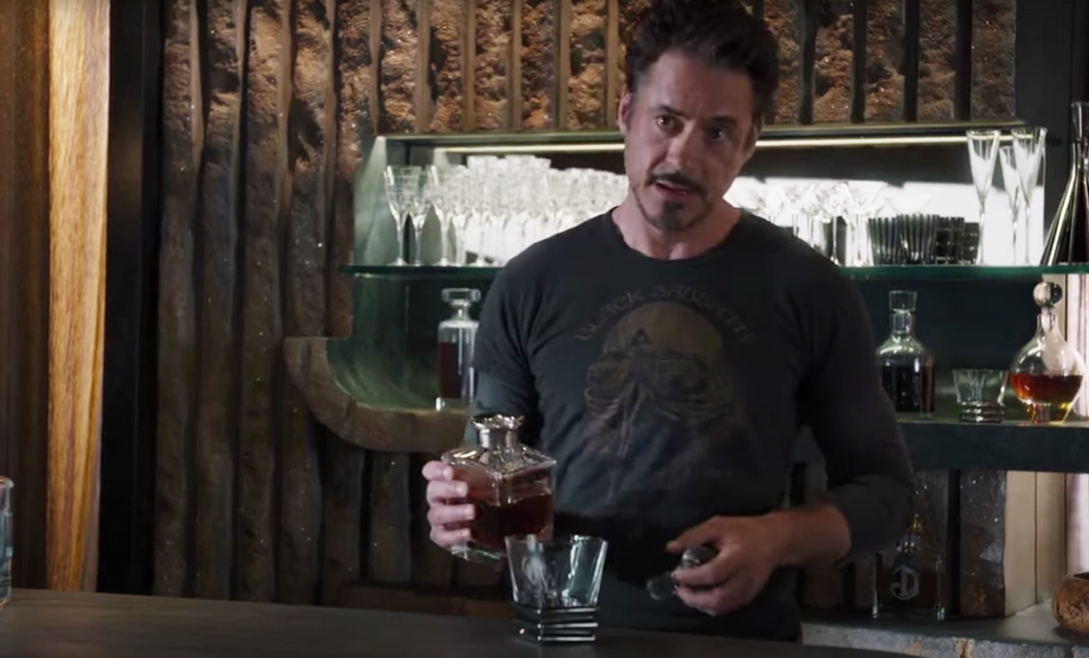 Tony Stark pours himself a whiskey in The Avengers. whiskey glasses in film
