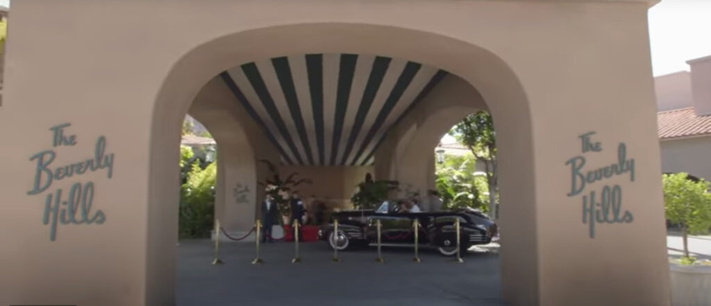 The entrance to The Beverly Hills Hotel with the famous green and white stripes