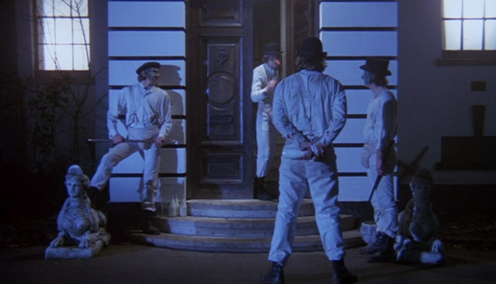 Alex exits Cat Lady's house sphinxes in A Clockwork Orange