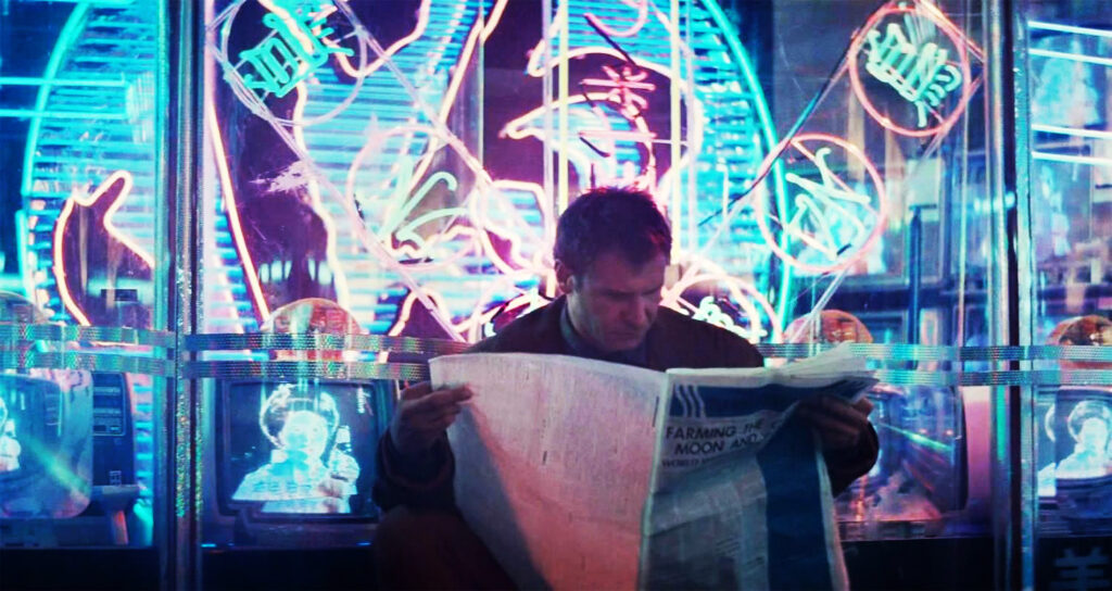 Deckard reads a newspaper whilst awaiting a seat at the noodle bar in Blade Runner Neon lighting in film